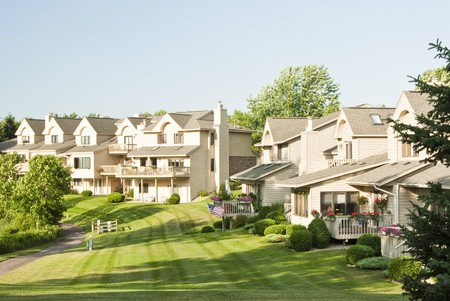 View of the back yards of multiple family residences in a suburban neighborhood. Banco de Imagens