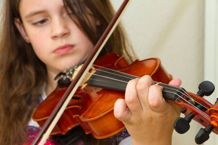 fiddle: Little girl with violin Stock Photo