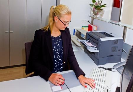 Secretary working in office