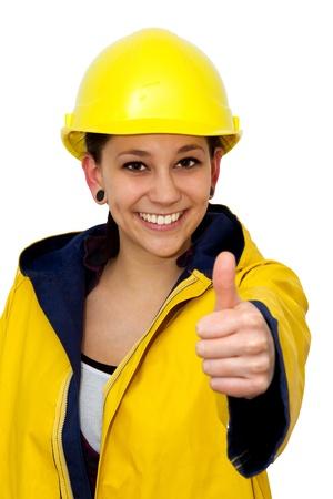 Vrouw in werkkleding met duim omhoog