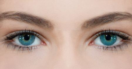 Blue eyes of a young woman 写真素材