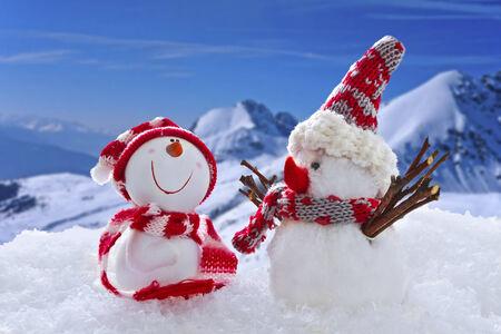 Snow man figures in winter photo