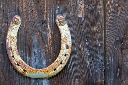 Horseshoe on a wooden background