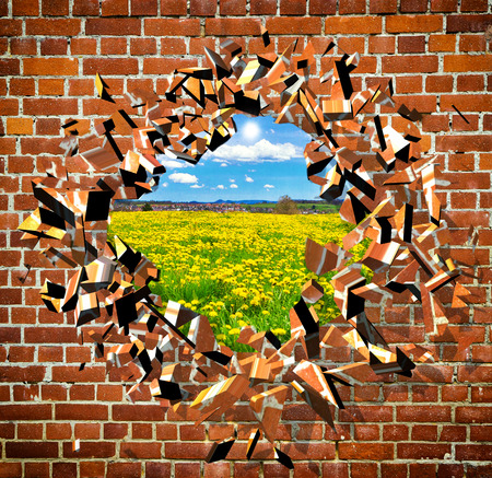 destroy: Broken Brick Wall with beautiful landscape behind Stock Photo