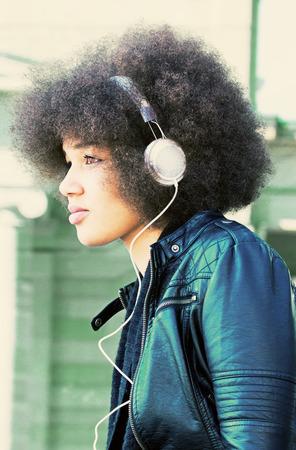 american media: Girl with headphones