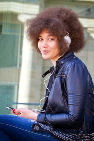 afro girl: Afro girl in the city with headphones