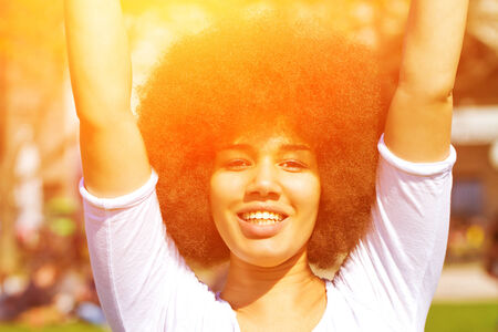 afro girl: Portrait of a cute cheerful afro girl in the sunshine