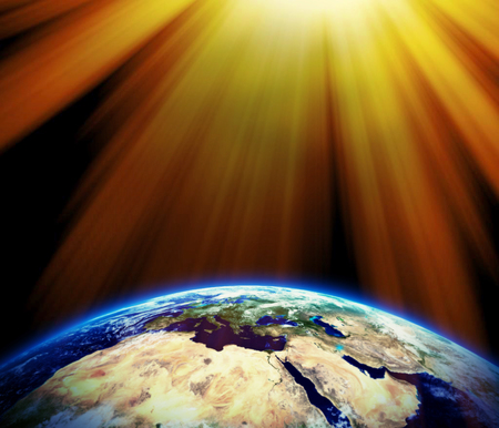 climate change: Bright sun rays on our earth - earth texture