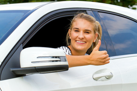 Happy girl in her new car photo