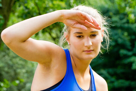 perspiration: Young woman sweating after sport Stock Photo