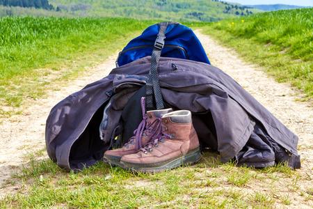 rainwear: Hiking equipment on a nature path Stock Photo