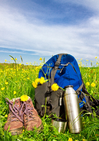 rucksack ': Hiking equipment on a flower meadow