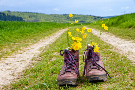 Hiking boots on a country lane