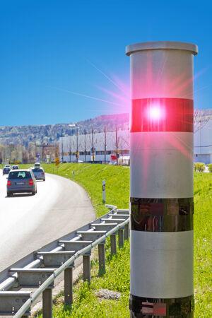 Modern speed camera on a highway
