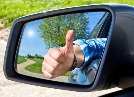 Car driver with thumb up Stock Photo