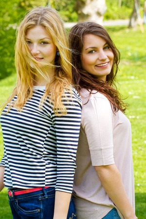 Two girl friends in the park photo