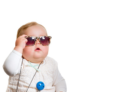 Toddler with sunglasses on white background Archivio Fotografico