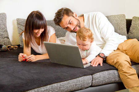 Family on a couch with laptop