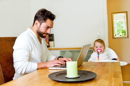 stay home work: Father working on computer at home