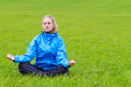 meditates: Young woman meditates in nature Stock Photo
