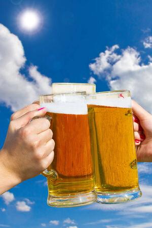 Fresh beer in mugs photo