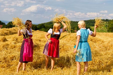 amity: Young women in dirndl having fun