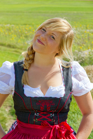 cheeky: Cheeky girl in a dirndl Stock Photo
