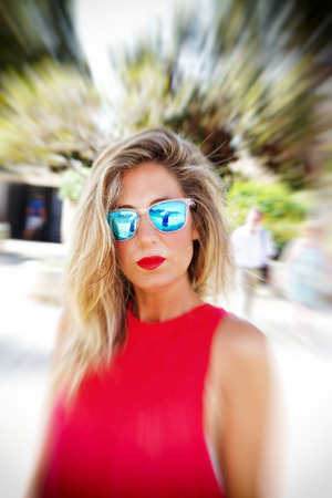 bellybutton: Cool blond woman with sunglasses - zoom effect Stock Photo