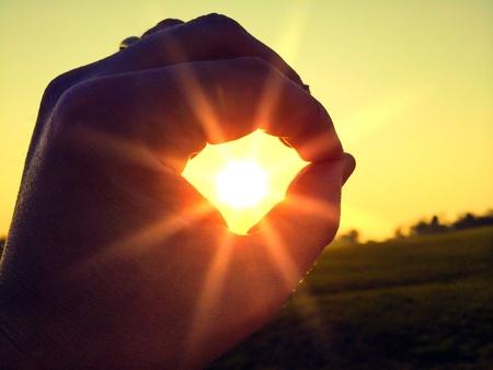 man: Sun in the hand