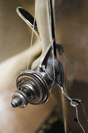 Closeup of a sewing machine  Thread tension regulator detail  photo