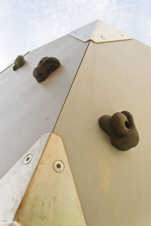 climbing  wall: Detail of an outdoor artificial climbing wall with some holds