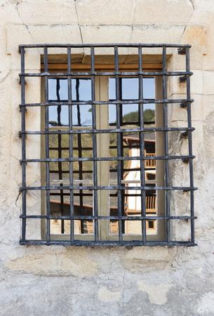 grille': Window with wrought iron grille in St Nicholas convent in Villafranca del Bierzo, Castilla y Leon, Spain. Stock Photo