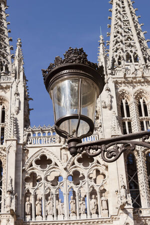 ornated: Old ornated iron street lamp and the cathedral at background in Burgos, Castilla y Leon, Spain. Stock Photo