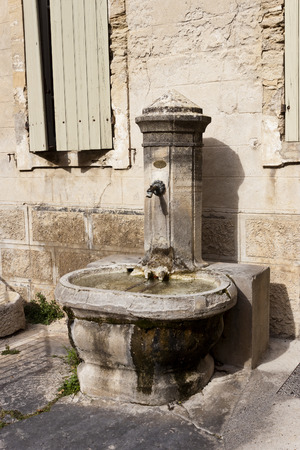 vaucluse: Old stone potable water public fountain in Gigondas, Vaucluse, France.