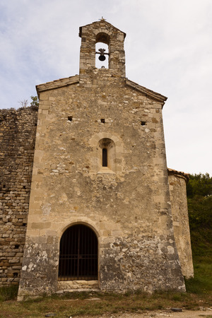 16th: Facade of the transept of the romanesque chapel of Saints Cosmas and Damian, 16th century, in Gigondas, Vaucluse, Provence-Alpes-Cte d