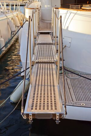 telescopic: Extended telescopic gangway between dock and boat for easy access. The passerelle is made of teak; aluminum and ropes.