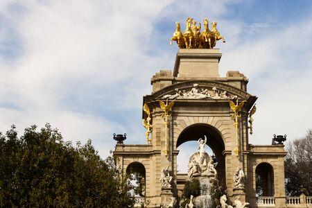quadriga: Quadriga of Aurora on top of the Cascada font in Ciutadella Parc in Barcelona, Spain.