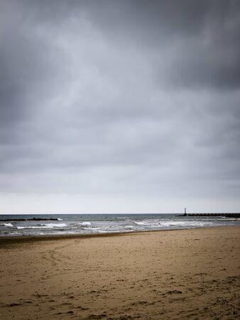 Cloudy day on the beach of Cubelles, Barcelona, Catalonia, Spain. Mediterranean overcast seascape in Garraf coast. Stock Photo