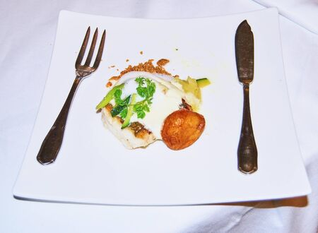 well presented fish dish with potatoes and cutlery Stockfoto