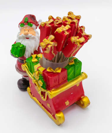 Santa with a sleigh and his gifts