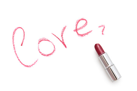 Inscription  love  on a white background  The inscription is made using lipstick