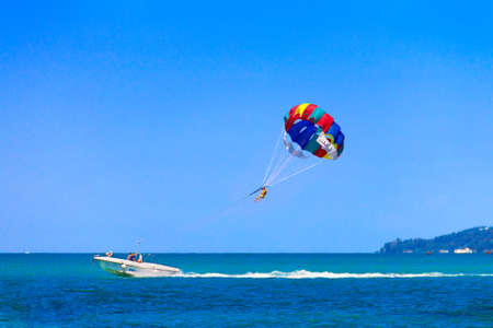 parasailing: Parasailing is a popular pastime in many resorts around the world. The active form of relaxation. Focus on a parachute.  Stock Photo