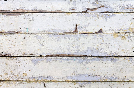 Texture in the form of boards, in which the old paint peeled off in places.
