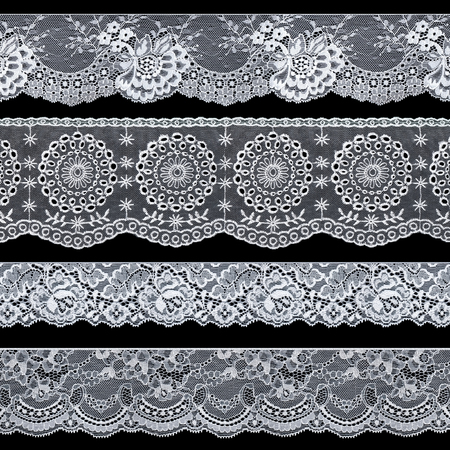 Set of elegant white lace ribbons on a black background. Lace braid. Vintage style.