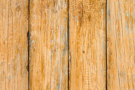 Old wooden boards with peeling paint. Wooden fence. Grunge style. Old decoration.