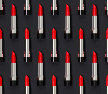 Seamless red lipstick pattern on a black background. 3d illustration. Beauty style. The lipsticks are arranged vertically.