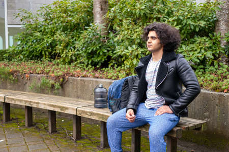 College students sitting on benches and taking a break