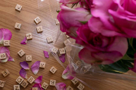 """Pink roses and the letters """"LOVE"""""""