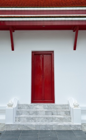 The red wooden door of Thai temple photo