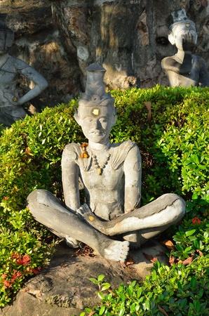 Vintage hermit statue illustrated Yoga at Wat Pho Thailand. photo